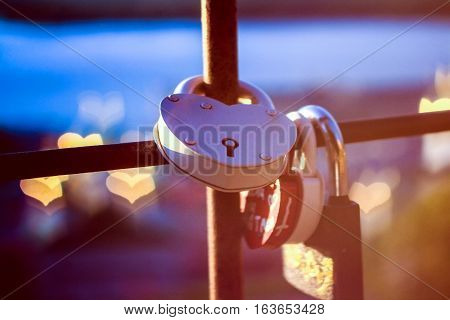 Iron lock heart with heart bokeh at background