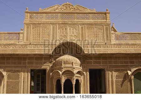 JAISALMER, RAJASTHAN, INDIA - FEBRUARY 18, 2008: Intricately carved facade of the honey coloured Jawahar Vilas Palace in the desert city of Jaisalmer in Rajasthan, India. Rajput style architecture.