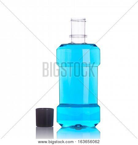 Bottle Of Blue Mouthwashes. Studio Shot Isolated On White