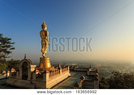 Golden Buddha Statue In Thai Temple, Wat Phra That Khao Noi In Nan Province, Thailand