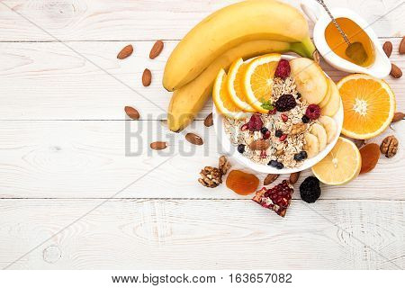Healthy Breakfast. Muesli, Yogurt, Honey And Fruits On White Table.
