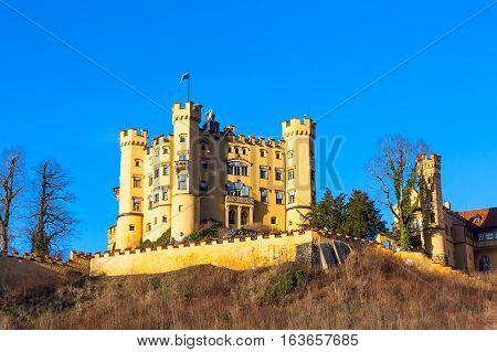 Hohenschwangau Castle Schloss in bavarian alps against blue sky, Fussen, Bavaria, Germany