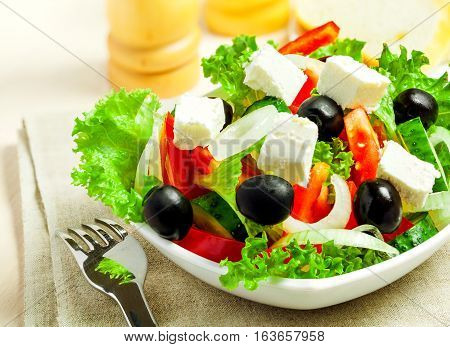 Greek vegetable salad with feta cheese top view