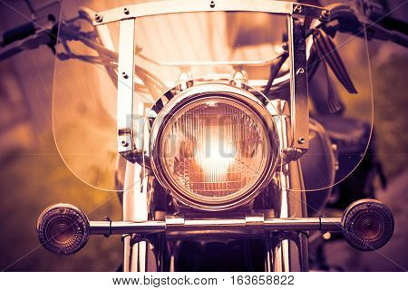 Close up shot of a motorcycle headlight lamp.