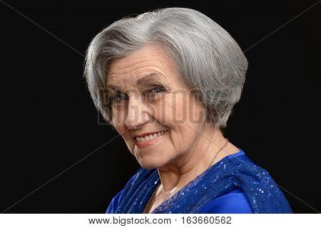 beautiful mature woman, posing on black background