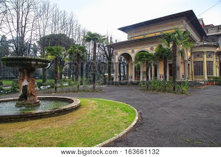 ancient thermal baths Exelsior and fountain in city park in Montecatini Terme, Tuscany, Italy in winter