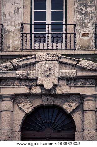 Statue above an archway in lisbon portugal