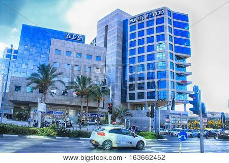 HERZLIYA, ISRAEL - AUGUST 31, 2015: Streets and modern building in Herzliya, Israel. Herzliya Pituach is a sought-after venue for high-tech companies and one of Israel's most affluent neighborhoods.