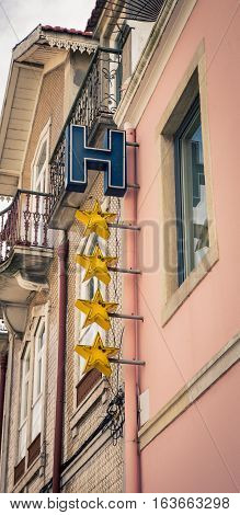 Hotel four star sign on a building in europe