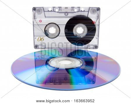 Analog audio tape cassette and digital compact disc isolated on a white background