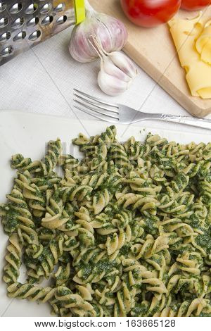 tasty pasta with spinach  for dinner, copy space