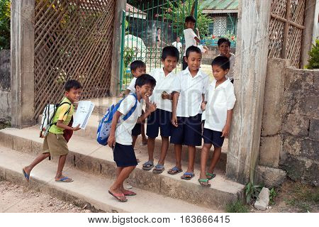 POPOTOTAN ISLAND PHILIPPINES - JANUARY 202012: Children go to school for a lesson