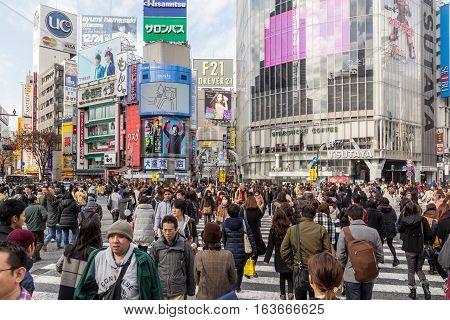 Tokyo, Japan - December 21, 2014: People walking over the famous Shibuya crossing in Tokyo