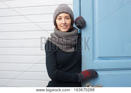 Girl Joyfully Puts On Or Takes Off His Hat In Cold Weather