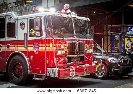 New York, United States of America - November 20, 2016: Close-up of a fire truck with a Batman figur hanging in front