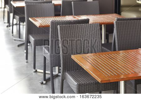 black rattan table and chair on the terrace at the patio