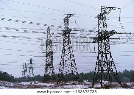 Pylon and transmission power line in summer day