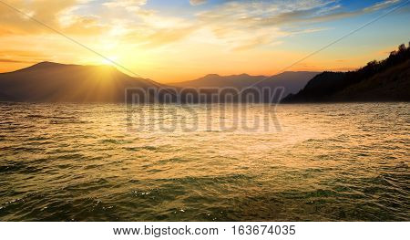 Sea and high mountains at the sunrise