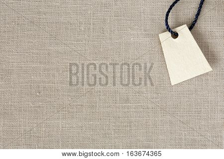 Light Neutral Beige Fabric Background And Blank Price Tag