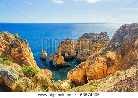 beautiful sea view of Atlantic ocean with rocks and cliffs at Ponta da Piedade Algarve region Portugal