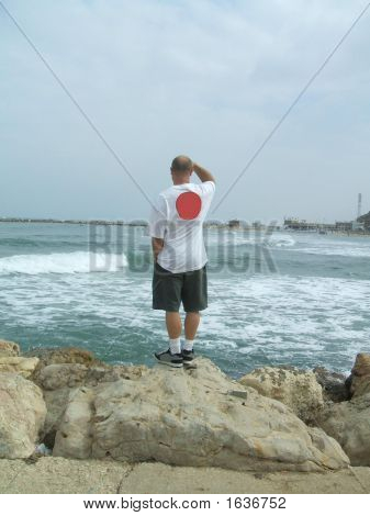 Man Standing Alone On The Beach