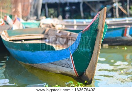 Old Blue Boat on the Water.Boat popularity use for boating relax or sell something at floating market.