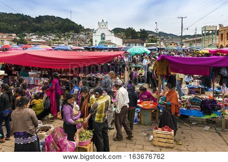 San Juan Chamula - May 11 2014: Local people in a street market in the town of San Juan Chamula Chiapas Mexico