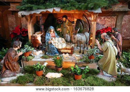 Biblical scene when the Three Kings coming to Bethlehem. Nativity scene with three kings. Jesus Mary and Joseph in the stable with the Kings