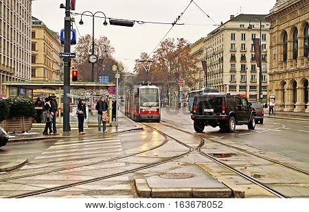 VIENNA, AUSTRIA - JANUARY 2, 2008: Public transportation with tram near Vienna State Opera at the city center of Austria's capital city Vienna