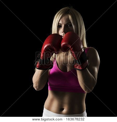 Young fit female athlete on a boxing training