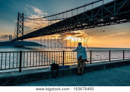 Man Take Akashi Kaikyo Bridge Photo In Kobe Japan