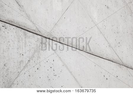 Wall of exposed concrete, architectural concrete wall, concrete symbol, reinforced concrete construction detail