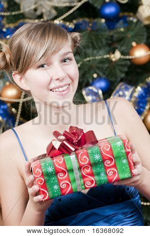 Young girl with Christmas present poster