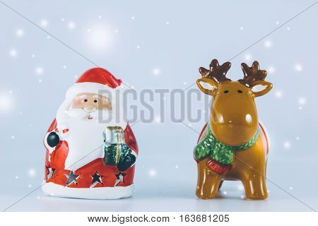 Santa Claus And Reindeer Stand On White Background