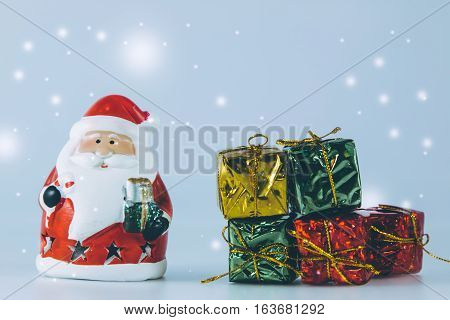 Santa Claus And Present Stand On White Background