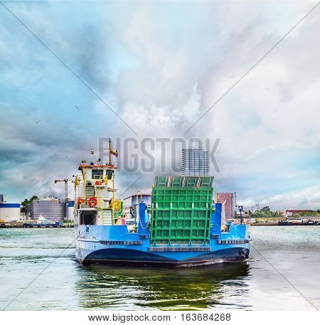 Ferryboat in Klaipeda harbor in a cloudy day