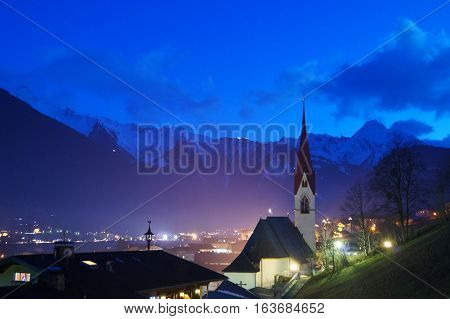 Illuminated church Chapel in a mountainous region the alps at night