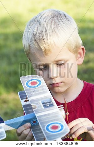 Child young boy and his RC plane toy