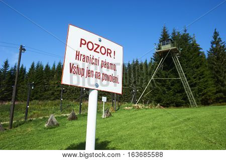 Remains of iron curtain on Czech-German border, an unique original rest of the iron curtain electric fence. Inscription on the sign means - beware! forbidden zone, no entry