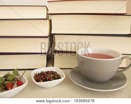 Thick books and a cup of tea for leisure time