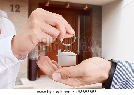 Man is collecting the key to his own house