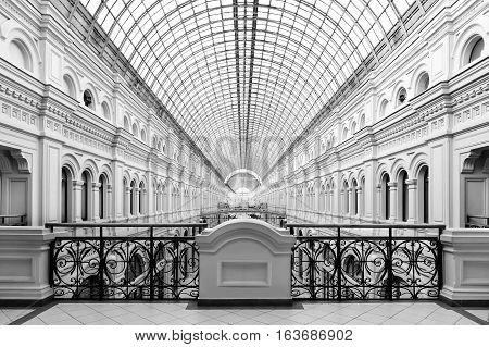 Architectural grand building in classicism style with curved glass transparent arch and forged fence, eighteenth century, symmetrical shot