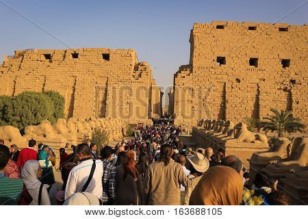 Karnak Luxor Egypt - February 5 2016: Crowded entrace in the Avenue of the Sphinxes from Ancient Egypt at Karnak Temple Luxor