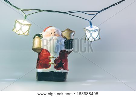 Santa Claus And Light Bulb On White Background