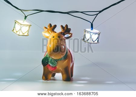 Reindeer And Light Bulb On White Background