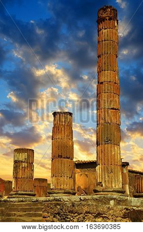 Ancient city of Pompeii at sunset, Italy. Roman town destroyed by Vesuvius volcano.