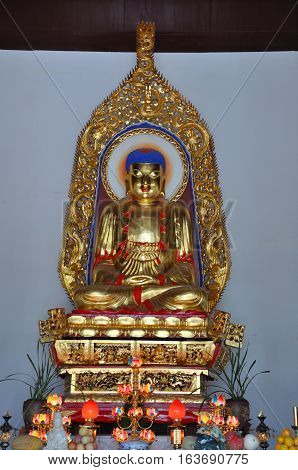 Gilt-Bronze Statue of Vairocana Buddha in Pilu Temple, Nanjing, Jiangsu Province, China. Pilu Temple was built in 1522 AD, and is one of the most antique temples in Nanjing.