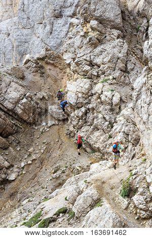 People climbing the Via Ferrata Severino Casara in Sexten Dolomites mountains South Tyrol Italy