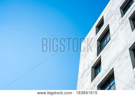 Concrete facade of building with windows, symbol modern architecture, concept new building, contemporary facade building