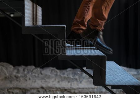 Man fleeing down stairs, staircase detail with human